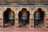 Rich decorated Bhutanese prayer wheels in Paro Rinpun Dzong - Western Bhutan — Stockfoto