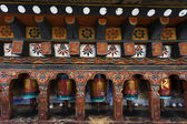 Prayer wheels in the Kyichu Lhakhang temple (Tibetan Buddhism) in Paro Valley, Western Bhutan - Asia — Stock Photo