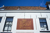 Spanish poem on the wall of a house in the center of Leiden, The Netherlands — Stock Photo