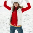 Stock Photo: Playful young woman in winter