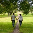 Back view of loving couple walking together — Stock Photo
