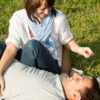 Young man and woman having fun at summer picnic — Stock Photo #20921043