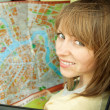 Young woman with road map in car during road trip — Stock Photo