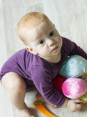 Top view of cute baby boy playing with toys and looking up — Stock Photo