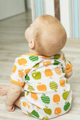 Back view of baby sitting and looking up — Stock Photo