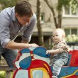 Father and son have fun at playground — Stock Photo