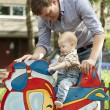 Father and baby son have fun at playground — Stock Photo