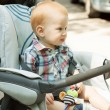 Stock Photo: Adorable baby boy sitting in stroller