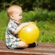 Stock Photo: Baby playing with yellow ball