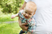 Happy laughing baby boy plaing with dad — Stock Photo