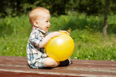 Baby playing with a yellow ball — Stock Photo