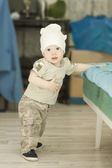 Adorable baby boy trying to stand up — Stock Photo
