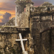 图库照片: Cross With Ancient Fort