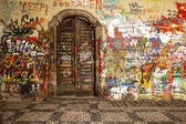 Wood Door In The Lennon Wall — Стоковое фото