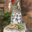 Stock Photo: Bali Statue With Food Offerings