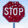 Stock Photo: Stop Sign With Bullet Holes