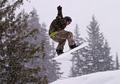 Jumping With A Snowboard — Stock Photo
