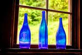 Three Blue Glass Bottles — Stock Photo