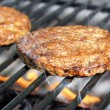 Burgers Sizzling On The Grill — Stock Photo
