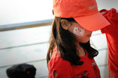 An unidentified chinese girl paint her face with NDP logo — ストック写真