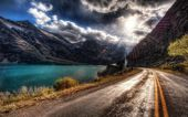 Mountain road along the river — Stock Photo
