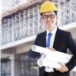 Asian developer with blueprints — Stock Photo #10503217
