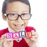 okul çocuğu gösteren Satılık kelime — Stok fotoğraf #12072282