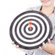 Businesswoman with dart board — Stockfoto