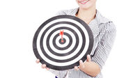 Businesswoman with dart board — Stock Photo