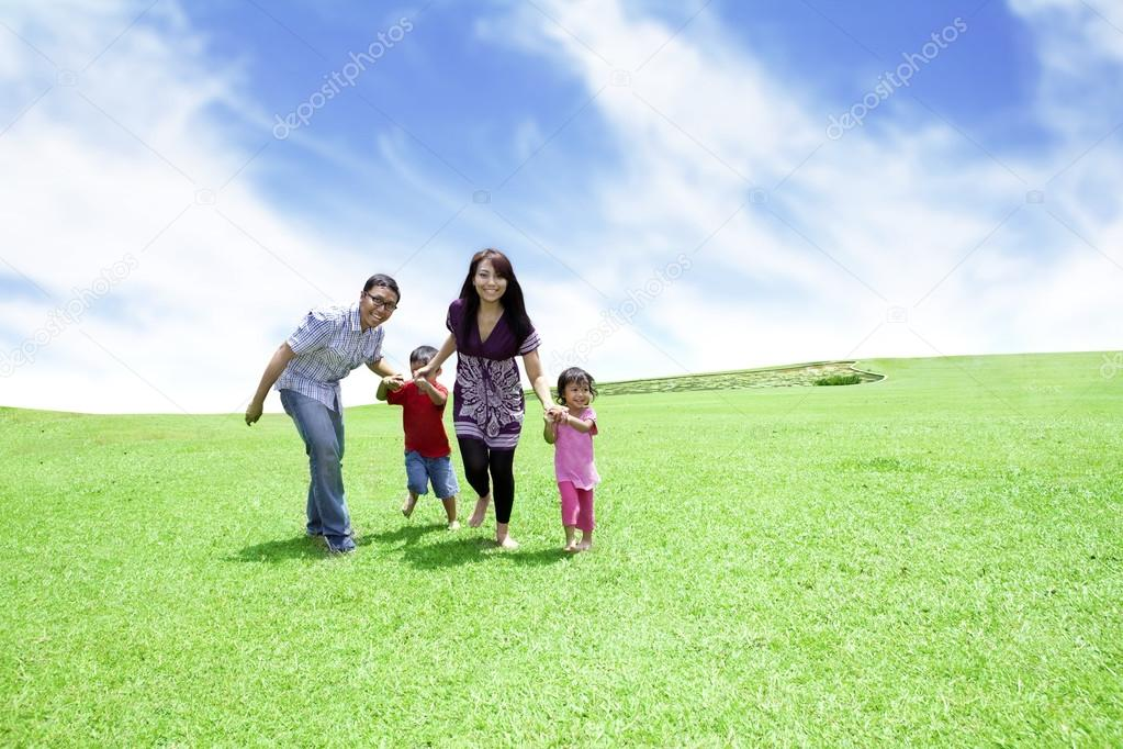 Happy family: Father, Mother, and their children. Shot outdoor in summer day  — Photo #12627478