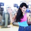 Asian woman loosing weight - Stock Photo