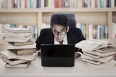Employee works in library — Stock Photo
