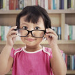 Cute girl wearing glasses — Stock Photo