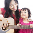 Musician with her daughter — Stock Photo