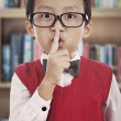 Student gesturing silence — Stock Photo #12808497