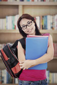 Friendly student in library — Stock Photo