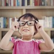 Female preschooler in library — Stock Photo