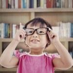 Female preschooler in library — Stock Photo