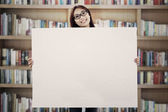 Asian woman showing empty banner — Stock Photo