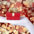 Christmas gift over defocused light — Stock Photo
