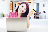Friendly woman online shopping — Stock Photo
