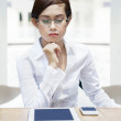 Businesswoman with mobile devices — Stock Photo