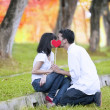 Couple kissing in autumn day — Stock Photo