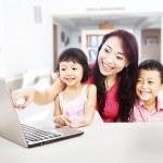 Happy family enjoying entertainment on laptop — Stock Photo