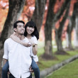 Asian couple piggy back — Stock Photo