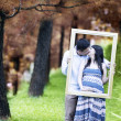 Romantic pregnant couple on autumn day — Stock Photo