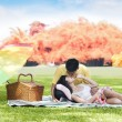 Young couple in the park — Stock Photo #13357740