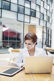Businesswoman working with laptop and ipad — Stock Photo