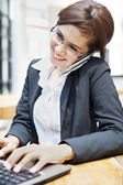 Young businesswoman working at restaurent — Stockfoto
