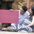 Happy parents to be holding red copyspace — Stock Photo #13520332